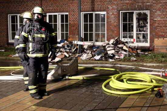 Firemen at the scene of an arson attack on the headquarters of German daily Hamburger Morgenpost, in Hamburg, Germany, January 11, 2015. (EPA/BODO MARKS)