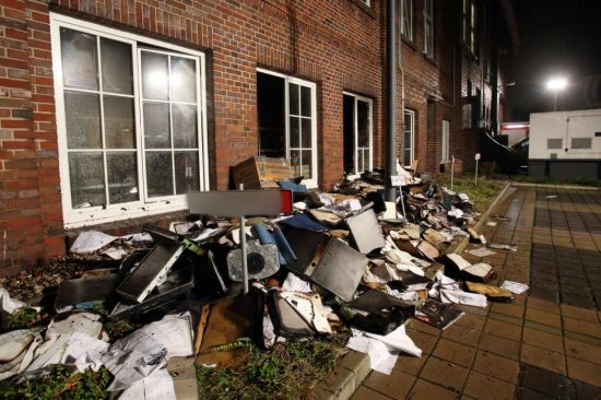 Burned files and newspaper issues pile up in the backyard of the 'Hamburger Morgenpost' in Hamburg, Germany, January 11, 2015. (EPA/BODO MARKS)