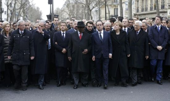 French President Francois Hollande is surrounded by head of states including (first row,LtoR) European Commission President European Commission President Jean-Claude Juncker, Israel's Prime Minister Benjamin Netanyahu, Mali's President Ibrahim Boubacar Keita, Germany's Chancellor Angela Merkel, Palestinian President Mahmoud Abbas and Italy's Prime Minister Matteo Renzi as they attend the solidarity march (Marche Republicaine) in the streets of Paris January 11, 2015. French citizens will be joined by dozens of foreign leaders, among them Arab and Muslim representatives, in a march on Sunday in an unprecedented tribute to this week's victims following the shootings by gunmen at the offices of the satirical weekly newspaper Charlie Hebdo, the killing of a police woman in Montrouge, and the hostage taking at a kosher supermarket at the Porte de Vincennes. (REUTERS/Philippe Wojazer)