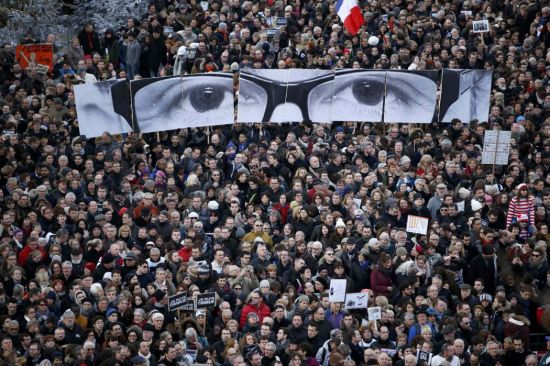 Hundreds of thousands of French citizens take part in a solidarity march (Marche Republicaine) in the streets of Paris January 11, 2015. French citizens will be joined by dozens of foreign leaders, among them Arab and Muslim representatives, in a march on Sunday in an unprecedented tribute to this week's victims following the shootings by gunmen at the offices of the satirical weekly newspaper Charlie Hebdo, the killing of a police woman in Montrouge, and the hostage taking at a kosher supermarket at the Porte de Vincennes. (REUTERS/Charles Platiau)