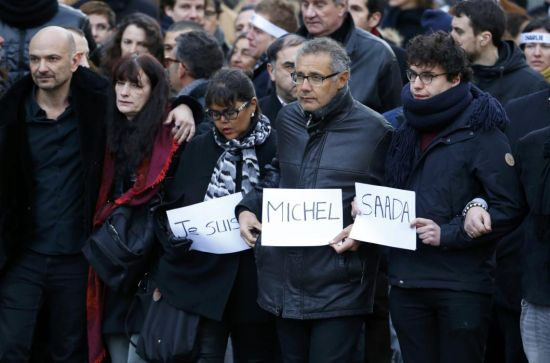 Family members and relatives of the seventeen victims take part in a solidarity march (Marche Republicaine) in the streets of Paris January 11, 2015. Hundreds of thousands of French citizens will be joined by dozens of foreign leaders, among them Arab and Muslim representatives, in a march on Sunday in an unprecedented tribute to this week's victims, including journalists and policemen, following the shootings by gunmen at the offices of the satirical weekly newspaper Charlie Hebdo, the killing of a police woman in Montrouge, and the hostage taking at a kosher supermarket at the Porte de Vincennes. (REUTERS/Yves Herman)