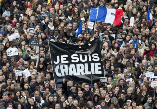 Thousands of people gather at Republique square in Paris, France, Sunday, Jan. 11, 2015. Thousands of people began filling France's iconic Republique plaza, and world leaders converged on Paris in a rally of defiance and sorrow on Sunday to honor the 17 victims of three days of bloodshed that left France on alert for more violence. (AP Photo/Peter Dejong)