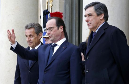 French President Francois Hollande (C) welcomes former French President Nicolas Sarkozy (L), head of the French conservative party UMP party, and former prime minister Francois Fillon (R)at the Elysee Palace before attending a solidarity march (Marche Republicaine) in the streets of Paris January 11, 2015. Hundreds of thousands of French citizens will be joined by dozens of foreign leaders, among them Arab and Muslim representatives, in a march on Sunday in an unprecedented tribute to this week's victims following the shootings by gunmen at the offices of the satirical weekly newspaper Charlie Hebdo, the killing of a police woman in Montrouge, and the hostage taking at a kosher supermarket at the Porte de Vincennes. (REUTERS/Philippe Wojazer)