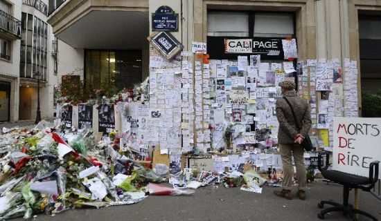People visit a makeshift memorial near the headquarters of the French satirical weekly Charlie Hebdo on January 12, 2015 in Paris (AFP Photo/Bertrand Guay)