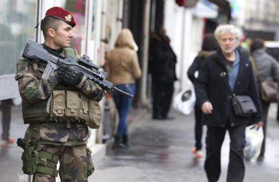 A soldier patrols outside a synagogue in Paris, Monday, Jan. 12, 2015. France on Monday ordered 10,000 troops into the streets to protect sensitive sites after three days of bloodshed and terror, amid the hunt for accomplices to the attacks that left 17 people and the three gunmen dead. (AP Photo/Jacques Brinon)