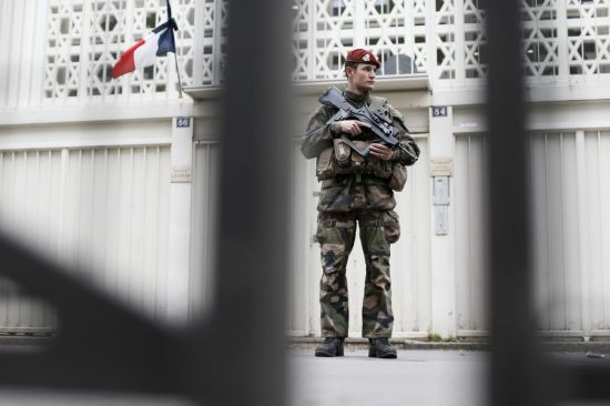 A French soldier secures the access to a Jewish school in Paris as part of the highest level of