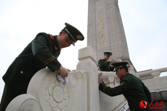 Soldiers clean the Monument of the People's Heroes on Tian'anmen square.