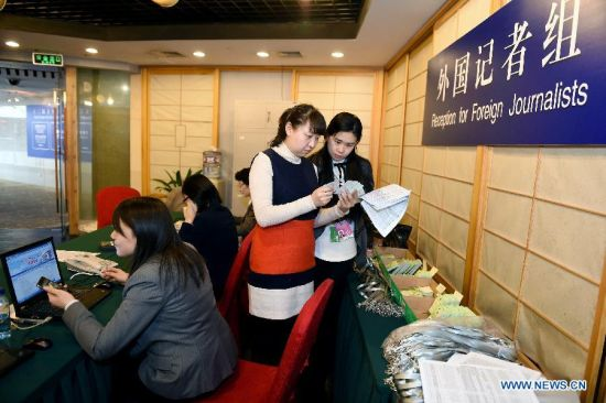 Staff members work at the Reception for Foreign Journalists in Beijing, China, March 1, 2015. Foreign journalists reporting the third session of the 12th National People's Congress (NPC) and the third session of the 12th Chinese People's Political Consultative Conference (CPPCC) began to register on Sunday at the Media Center Hotel in Beijing. (Xinhua/Li Xin)