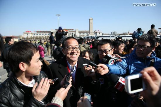 Yu Minhong, owner of the New Oriental Education Group and a member of the 12th National Committee of the Chinese People's Political Consultative Conference (CPPCC),receives interview before the opening of the third session of the 12th CPPCC National Committee in Beijing, capital of China, March 3, 2015. (Xinhua/Wang Shen)