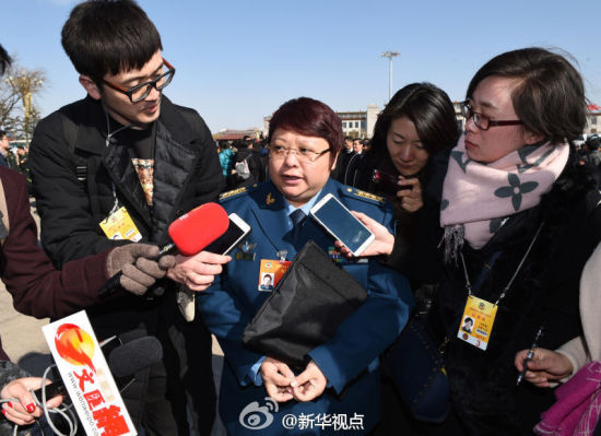 Famous singer Han Hong, as a member of the 12th Chinese People's Political Consultative Conference (CPPCC) National Committee, receives interview before the opening of the third session of the 12th CPPCC National Committee in Beijing, capital of China, March 3, 2015.