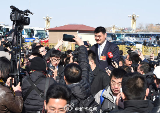 Basketball star Yao Ming, as a member of the 12th Chinese People's Political Consultative Conference (CPPCC) National Committee, receives interview before the opening of the third session of the 12th CPPCC National Committee in Beijing, capital of China, March 3, 2015.
