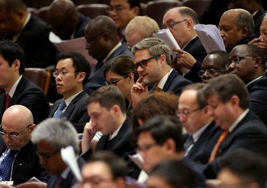 Foreign diplomats listen to the opening meeting of the third session of the 12th Chinese People's Political Consultative Conference National Committee at the Great Hall of the People in Beijing, March 3, 2015. [Photo by Jiang Dong/China Daily]