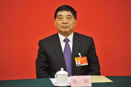 Photo shows Qiu He, deputy Party chief of Yunnan Province and president of Yunnan Communist Party School, attended a meeting of the Yunnan delegate for National People's Congress in Beijing on March, 3, 2015.