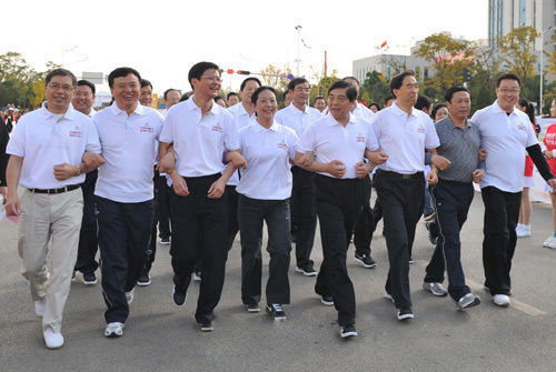 """Qiu He attended the """"World's Walking Day"""" event in November, 2011 with residents of Kunming, capital city of Yunnan province."""