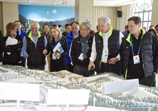 Members of the 2022 Evaluation Commission of the International Olympic Committee (IOC) check the sand box of sport stadiums in Beijing on March 25, 2015. The International Olympic Committee (IOC) team is visiting Beijing this week to assess its bid to host the Games ahead of a July vote that the Chinese capital -- which hosted the spectacular 2008 summer Games. (Xinhua/Gong Lei)