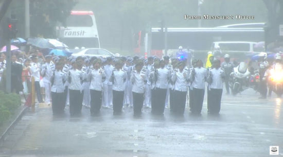 Tens of thousands of Singaporeans undeterred by heavy rains lined a 15 kilometer (9 mile) route through the Southeast Asian city-state to witness an elaborate funeral procession Sunday for longtime leader Lee Kuan Yew, who died Monday at 91.