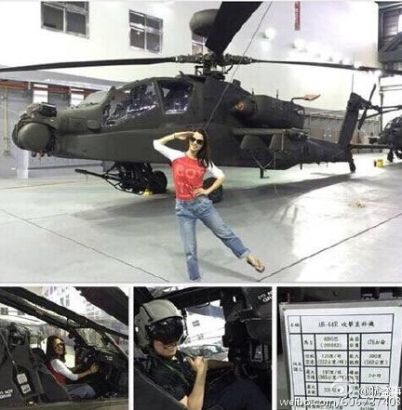 Janet Lee poses in front of the AH-64E Apache attack helicopter