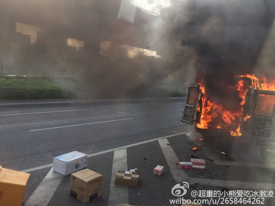 Part of the goods were scattered along the road, and sounds of blasts could be heard.