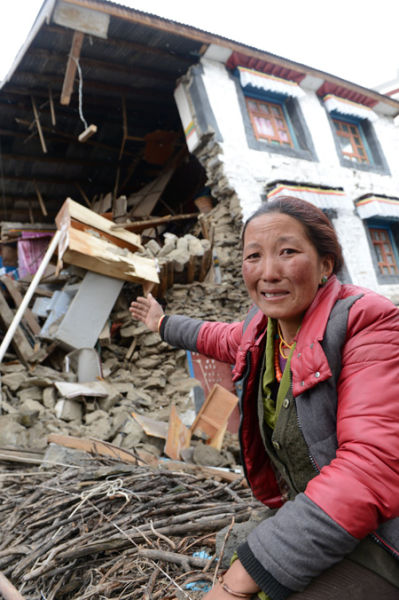 A villager weeps in front of her ruined home in Nyalam county in China's Tibet autonomous region. JOGO/XINHUA