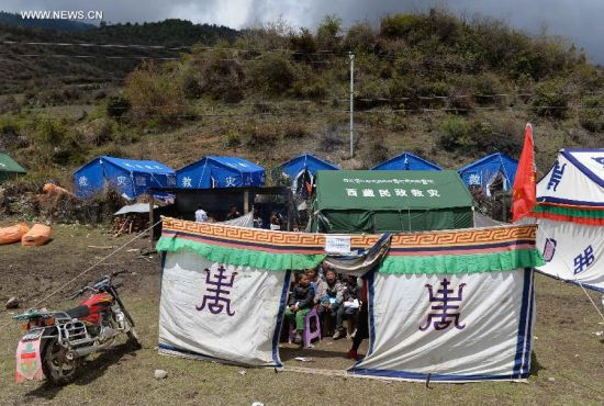 Students attend English class at the temporary tent classroom in Gyirong County, April 29, 2015.