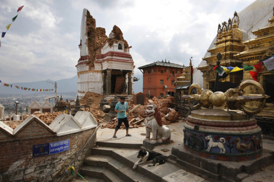 In this April 30, 2015 photo a man walks through the famous Swayambhunath stupa after it was damaged in the April 25 massive earthquake in Kathmandu, Nepal. [Photo/IC]