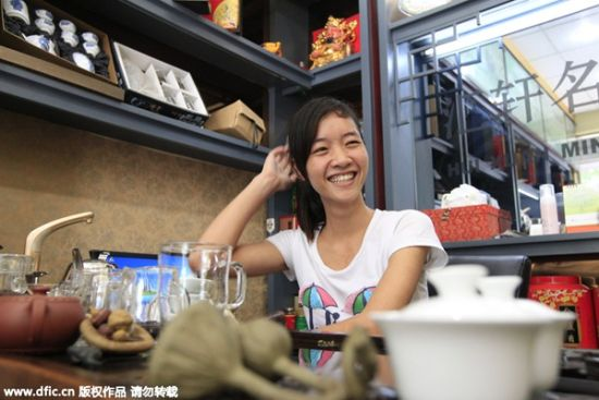 Liang Shichui, a Vietnamese bride, works at her sister's husband's tea shop in Linqi town, Linzhou of Central China's Henan province on July 24, 2013. She cannot seek a job on the open job market, because she has neither a work permit or a green card. [Photo/IC]