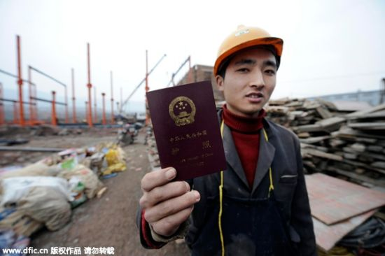Hong Lin, 22, a migrant construction worker, shows his passport, in Southwest China's Chongqing municipality on Jan 24, 2010. He planned to go to Vietnam to seek a bride himself. [Photo/IC]