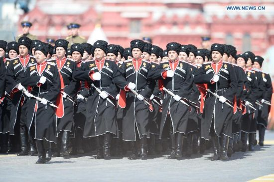 The Battalion of the Kuban Cossacks takes part in the military parade marking the 70th anniversary of the victory in the Great Patriotic War, in Moscow, Russia, May 9, 2015. (Xinhua/Jia Yuchen)