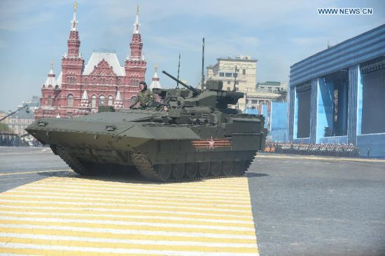A T-15 Tracked Heavy Armored Vehicle moves on the Red Square during a military parade marking the 70th anniversary of the victory in the Great Patriotic War, in Moscow, Russia, May 9, 2015. (Xinhua/Jia Yuchen)