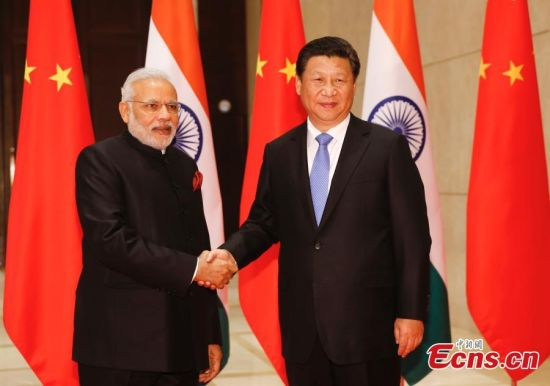 Chinese President Xi Jinping (R), meets Indian Prime Minister Narendra Modi on Thursday, May 14, 2015 in Xi'an, capital of Northwest China's Shaanxi Province. Thursday is the first day of Modi's three-day visit to China. (Photo: China News Service/ Du Yang)