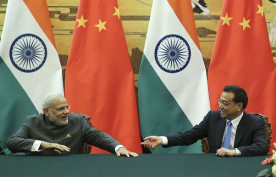 Chinese Premier Li Keqiang holds talks with Indian Prime Minister Narendra Modi at the Great Hall of the People, Beijing on Friday. [Photo by Zhao Yinan/chinadaily.com.cn]
