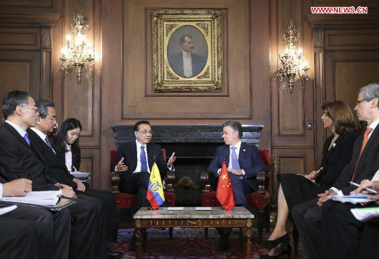 Chinese Premier Li Keqiang (L Back) holds talks with Colombian President Juan Manuel Santos (R Back) in Bogota, capital of Colombia, May 21, 2015. (Xinhua/Ding Lin)