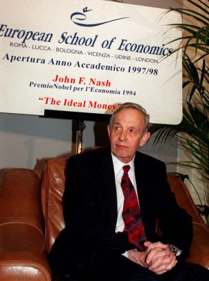 FILE - In this Oct. 28, 1997 file photo, John Forbes Nash, 1994 Economics Nobel Prize winner, takes a break during the European School of Economics conference in Rome. Nash, the Nobel Prize-winning mathematician whose struggle with schizophrenia was chronicled in the 2001 movie