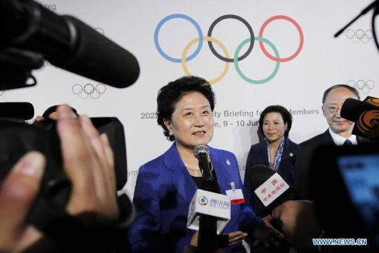 China's Vice Premier Liu Yandong (C) addresses to the media after the briefing for International Olympic Committee (IOC) members by the 2022 Winter Olympic Games candidate city of Beijing at the IOC Museum in Lausanne, Switzerland, on June 9, 2015. (Xinhua/Zhou Lei)