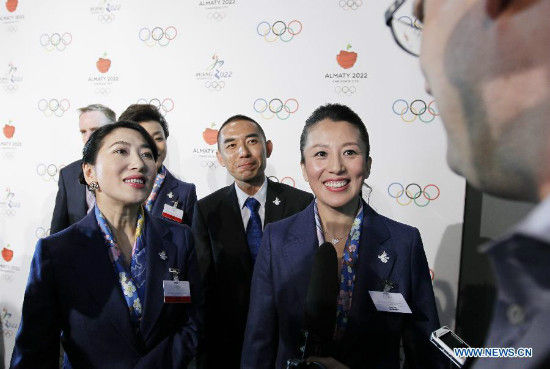 Yang Yang (R), Olympic champion of Shorttrack Speed Skating and IOC member, speaks to the media after the briefing for International Olympic Committee (IOC) members by the 2022 Winter Olympic Games candidate city of Beijing at the IOC Museum in Lausanne, Switzerland, on June 9, 2015. (Xinhua/Zhou Lei)
