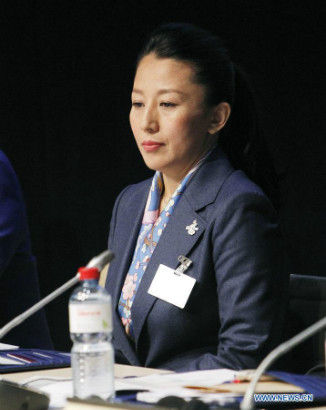 Olympic champion Yang Yang reacts at the presentation of Beijing Candidate City's bid for the 2022 Winter Olympic games, at the IOC Museum in Lausanne, Switzerland, on June 9, 2015. (Xinhua/Zhou Lei)