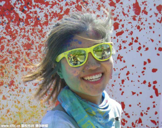 A girl takes part in a color run campaign in Beijing on June 20, 2015. The event was attended by nearly 20,000 people backing Beijing's Winter Olympics bid. [Photo/IC]