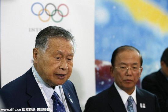 Tokyo 2020 Olympics President Yoshiro Mori, left, along with Tokyo 2020 Olympics CEO Toshiro Muto, talks to media after a presentation to the IOC committee in Kuala Lumpur, Malaysia, Wednesday, July 29, 2015. [Photo/IC]