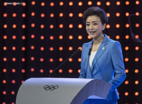 Yang Lan, head of the General Planning and Legal Affairs Department of the Beijing 2022 Olympic Winter Games Bid Committee, delivers a speech during Beijing's 2022 Olympic Winter Games bid presentation at the 128th IOC session in Kuala Lumpur, Malaysia, on July 31, 2015. The session will decide the host cities of the 2022 Olympic Winter Games and the 2020 Youth Olympic Winter Games. (Xinhua/Lui Siu Wai)
