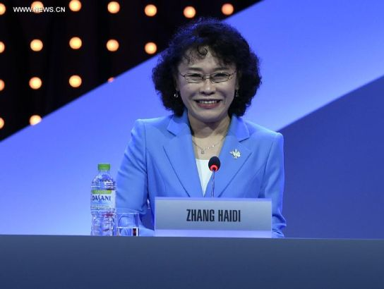 Zhang Haidi, vice president of the Beijing 2022 Olympic Winter Games Bid Committee and president of the National Paralympic Committee of China, delivers a speech during Beijing's 2022 Olympic Winter Games bid presentation at the 128th IOC session in Kuala Lumpur, Malaysia, on July 31, 2015. The session will decide the host cities of the 2022 Olympic Winter Games and the 2020 Youth Olympic Winter Games. (Xinhua/Gong Lei)