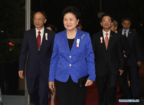 Chinese vice premier Liu Yandong (C), head of the Beijing 2022 Winter Olympics bid team, arrives for the opening ceremony of the 128th Session of the International Olympic Committee (IOC) at the Kuala Lumpur Convention Centre in Kuala Lumpur, Malaysia, July 30, 2015. The election of the host cities for the Olympic Winter Games 2022 and the Winter Youth Olympic Games 2020 will be the highlights of the upcoming IOC Session, which begins Friday and concludes on August 3. (Photo: Xinhua/Gong Lei)