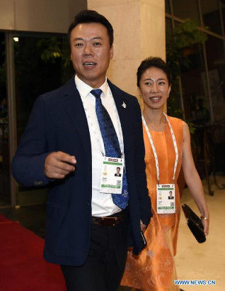 Former Chinese skaters Shen Xue (R) and Zhao Hongbo arrives for the opening ceremony of the 128th International Olympic Committee (IOC) session in Kuala Lumpur, Malaysia, July, 30, 2015. (Photo: Xinhua/Gong Lei)