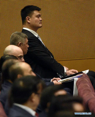 Former Chinese basketball player Yao Ming (Back) attends the opening ceremony of the 128th International Olympic Committee (IOC) session in Kuala Lumpur, Malaysia, July, 30, 2015. (Photo: Xinhua/Gong Lei)