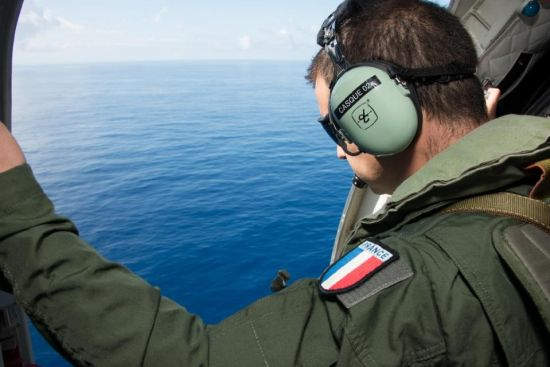 This picture taken by the ECPAD on August 9, 2015 shows a French serviceman looking out over the Indian Ocean, off the French overseas island of La Reunion, during searches for more wreckage of flight MH370 (AFP Photo/Patrick Becot)