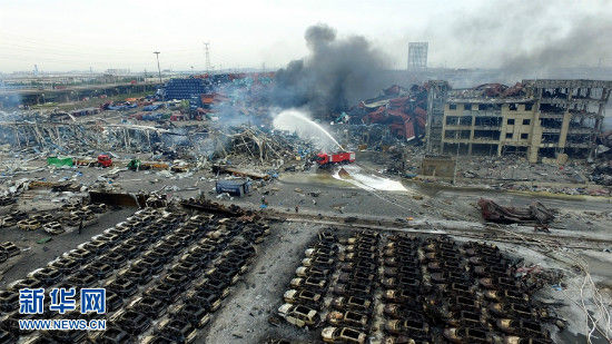 An aerial photo taken on Aug. 14, 2015 shows the explosion site in Tianjin, north China. The death toll from explosions occurred on Wednesday night rises to 85 as of Saturday morning. (Xinhua)