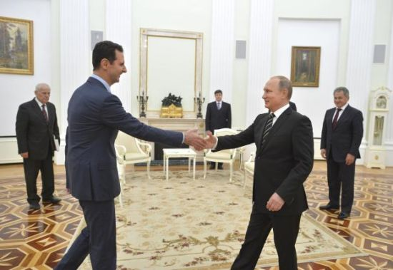 Syrian President Bashar Assad shakes hands with Putin in Moscow