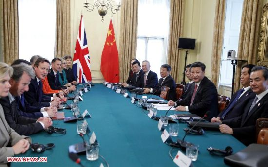 President Xi Jinping holds talks with British Prime Minister David Cameron at 10 Downing Street in London, Britain, Oct. 21, 2015. (Xinhua/Ju Peng)