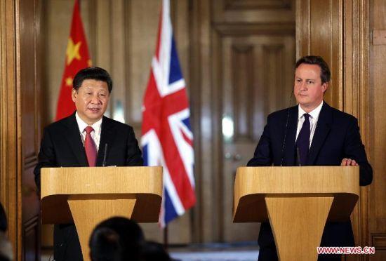 Xi, Cameron meet media after talks at Downing Street