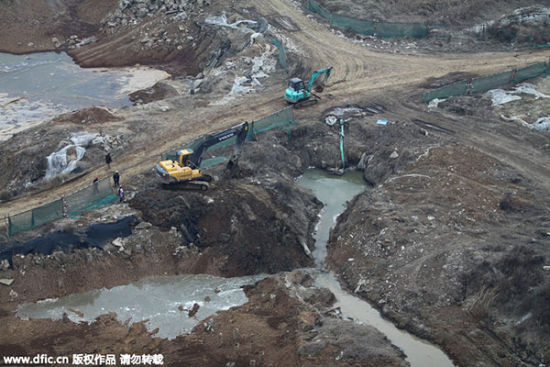 Soil is under restoration where an insecticide factory used to be located in Hanyang, Wuhan, Hubei province on Jan 5, 2013. [Photo/IC]