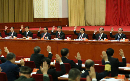 Top Communist Party of China (CPC) and state leaders Xi Jinping (rear, C), Li Keqiang (3rd R rear), Zhang Dejiang (3rd L rear), Yu Zhengsheng (2nd R, rear), Liu Yunshan (2nd L rear), Wang Qishan (rear R) and Zhang Gaoli (rear L) attend the Fifth Plenary Session of the 18th CPC Central Committee, in Beijing, capital of China. The meeting was held from Oct. 26 to 29 in Beijing. (Xinhua/Ma Zhancheng)